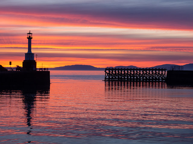 Photo of Maryport lighthouse at sunset
