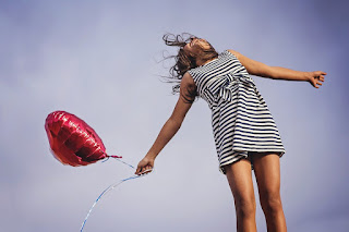 carefree woman with a balloon