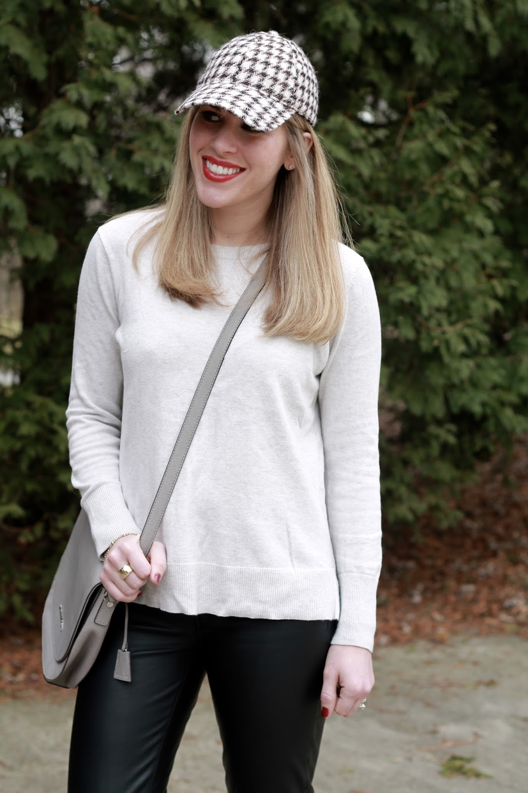 beige sweater, leather pants, burgundy velvet shoes, grey crossbody bag, tweed baseball hat