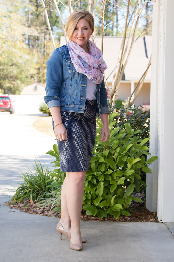 A dressy casual outfit with a scarf and a skirt