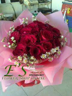 bunga tangan mawar merah bulat