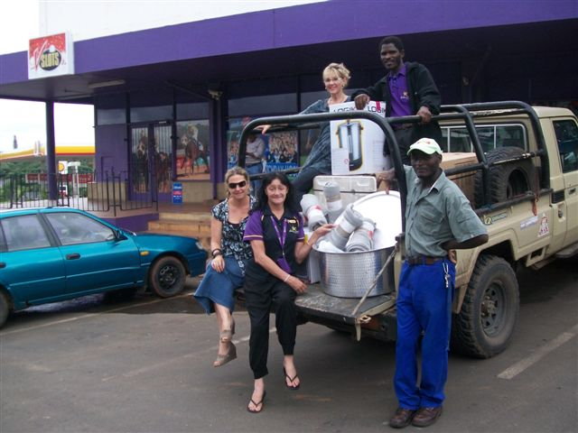 The Hollywoodbets Empangeni team with the donations they are about to make to the iZulu Orphan Project