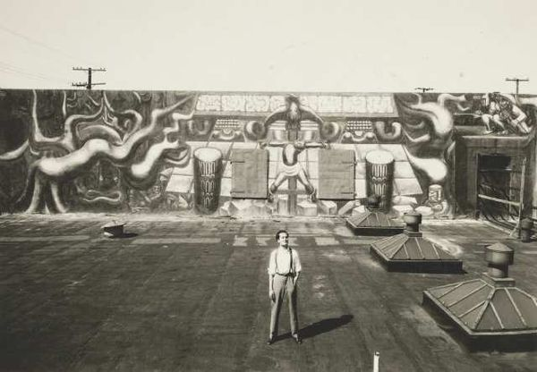 Roberto Berdecio, a close associate of Siqueiros, stands in front of América Tropical shortly after completion in the 1930s Photo: The Getty Research Institute, Los Angeles Mural: © 2012 Artists Rights Society (ARS), New York/SOMAAP, Mexico City http://www.getty.edu/conservation