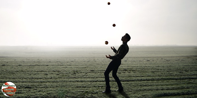 "Header image of the article: ""5 Positive Life Habits That Improved My Life"". Man trick with balls, empowered by is life improvement and personal development."
