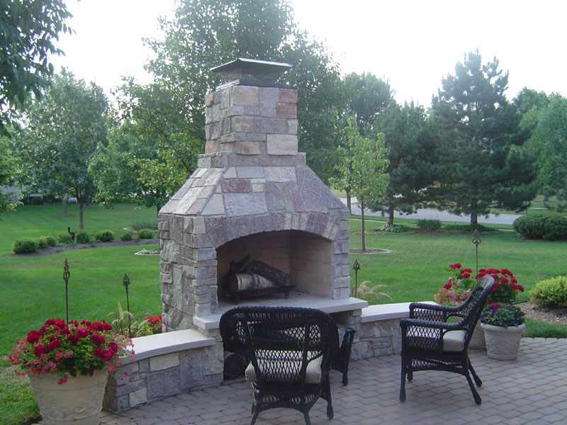 Evergreen Landscaping In Michigan Features Some Stone Age Fireplaces On Their Site Along With Lots Of Other Beautiful Landscape Designs
