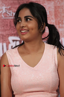Actress Srushti Dange Stills in Short Dress at Mupparimanam Press Meet  0021.jpg