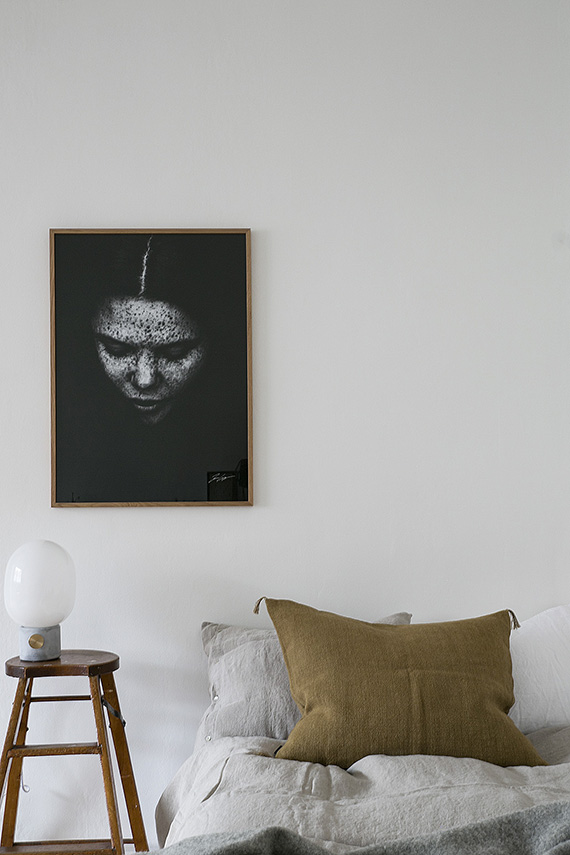 Bedrooms with black art via Fantastic Frank