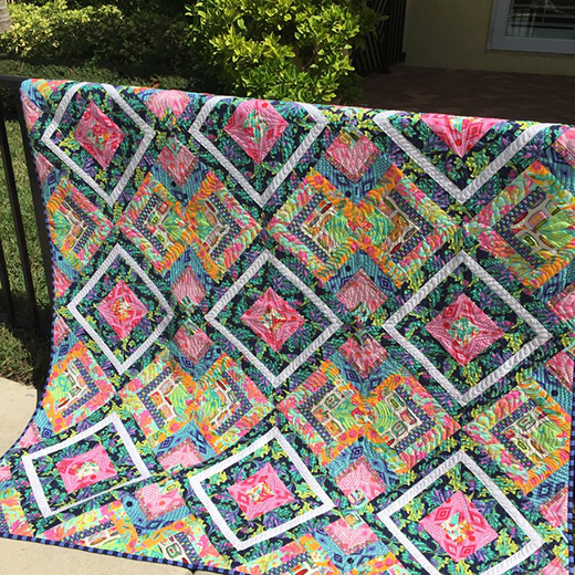 Twist and Shout Quilt made by StrawberryQuiltcake, The Pattern Designed by Stacey Day of Stacey in Stitches, Featuring Tabby Road by Tula Pink and True Colors by Tula Pink