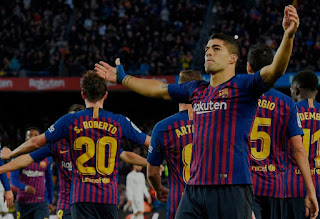 Barcelona thrashed Real Madrid to go top of the La Liga table