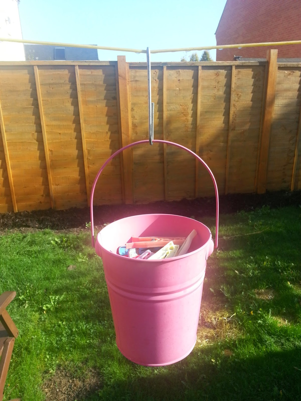 Metal Hanging Peg Holder, made from a decorative bucket