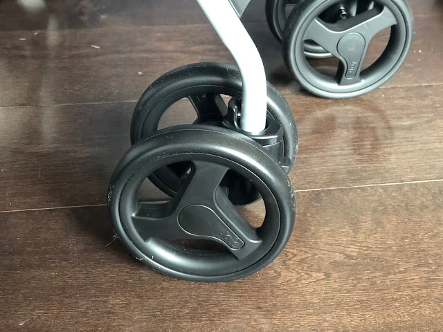 Close up of black pushchair wheels, unsurprisingly they are round