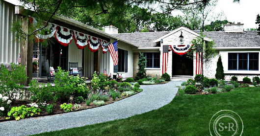 Patriotic Decorating Using American Flags and Red White and Blue Bunting