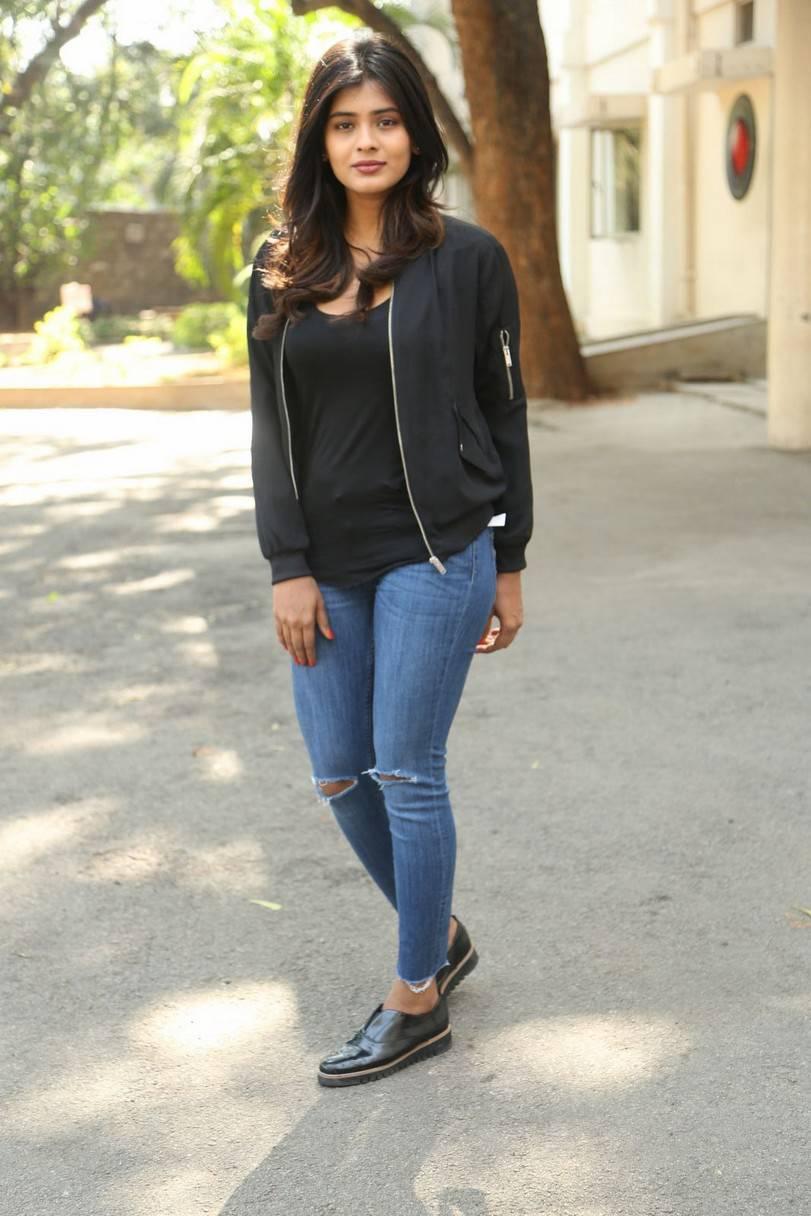 Actress Hebah Patel Long Hair In Black Top Blue Jeans