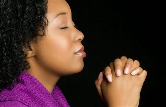 Black woman praying