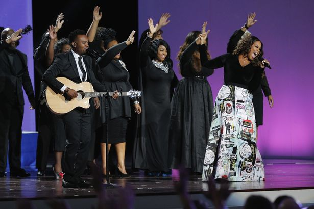 Gospel-Singer-Travis-Greene-L-and-RB-singer-Chrisette-Michele-R-perform-at-the-Liberty-Inaugu