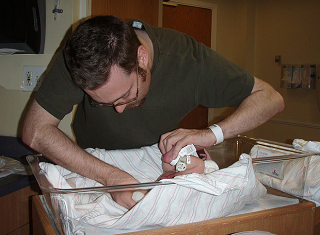 Image: Dad's First Diaper Change, by Christi on Flickr