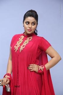 Actress Poorna Latest Stills in Red Dress at Rakshasi First Look Launch  0217.JPG