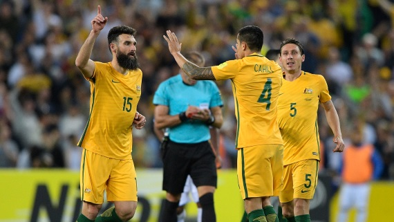 Mile Jedinak and Tim Cahill of Australia