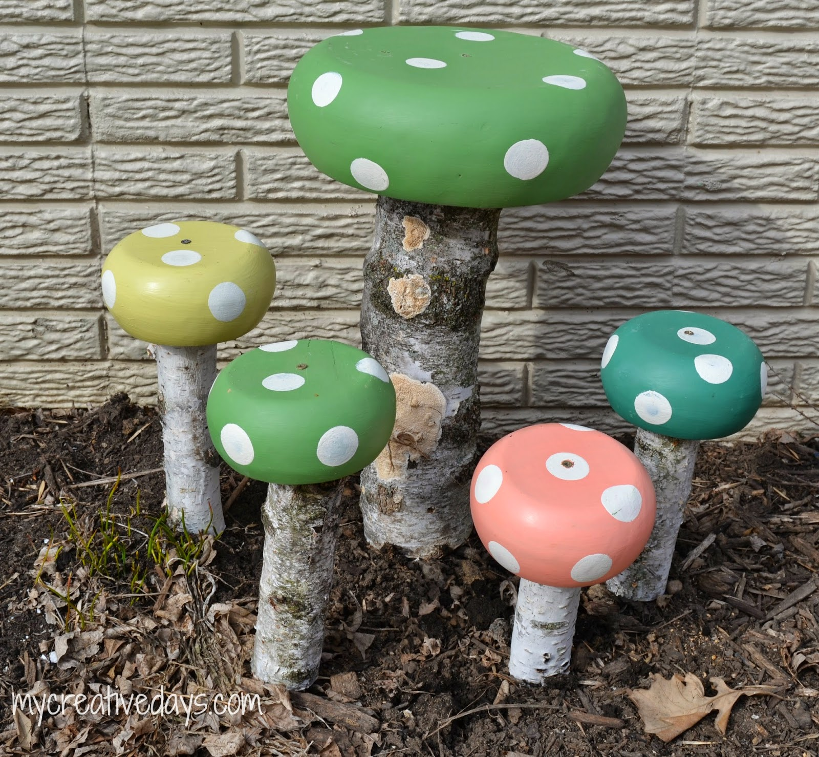 DIY mushroom toadstools in green, pink and turquoise.