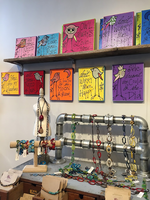 Inspirational signs and creative jewelry at Colored Squid Gallery
