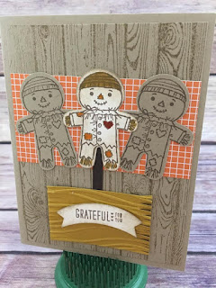 "This fall card uses Stampin' Up's Cookie Cutter Halloween stamp set and the Cookie Cutter Builder Punch.  The background is the Hardwood stamp, and the designer paper is Halloween Night Specialty Designer Paper.  The ""hay"" is a piece of Delightful Dijon cardstock embossed with the Seaside Folder and the edges cut with the Fringe Scissors.  The greeting is from Acorny Thank You and punched with the Duet Banner Punch.  www.stampwithjennifer.blogspot.com"