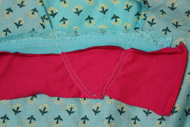 excess fabric at the neckline of tunic