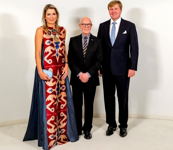 Queen Maxima wore Gianvito Rossi Lola frayed denim sandals and carried Bottega Veneta Knot satin and snakeskin clutch