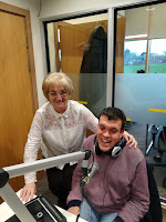 Image of guest Rosalie Marsh with presenter Dave Williams in front of the microphones in the studio
