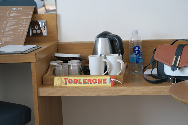 Settling in at the hotel with a Toblerone