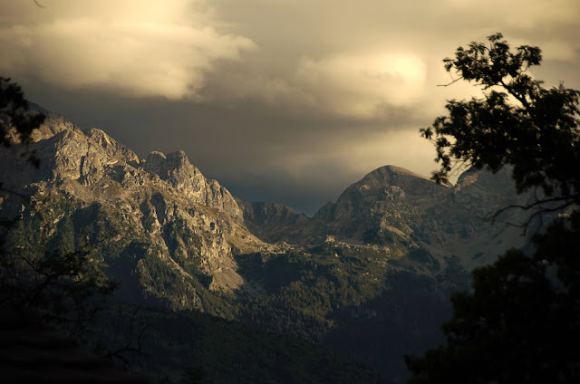 storm hovers over the mountains in St. Hilaire du Touvet, France