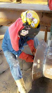 female welder tyra doing an weld joint