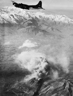 An American B17 bomber shortly after releasing its payload over Monte Cassino