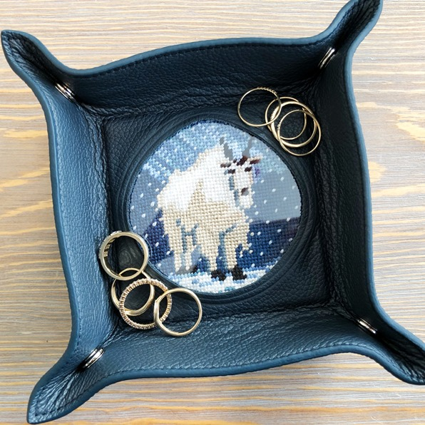 Blue leather ring dish with Martie the Mountain Goat needlepoint design by Thorn Alexander in the centre