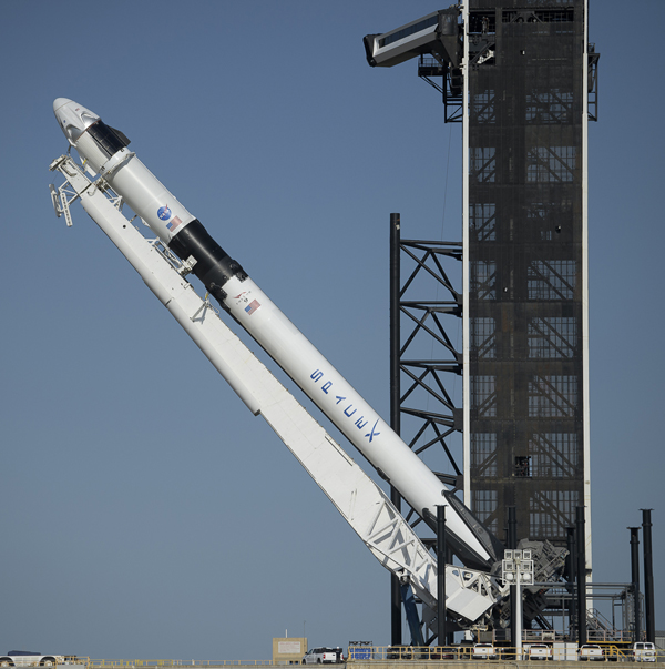 In preparation for its static fire, SpaceX's Falcon 9 rocket is raised to vertical on the pad at Kennedy Space Center's Launch Complex 39A...on May 21, 2020.