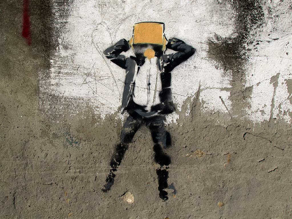 Livorno, raw stencil of a man with the head inside a box