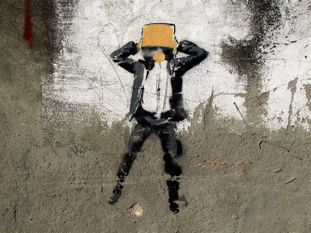 Raw stencil of a man with the head inside a box, Livorno
