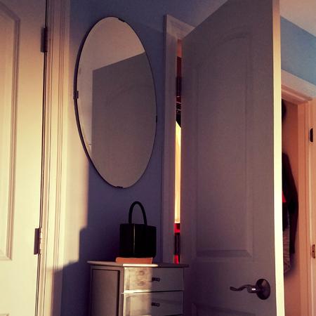 image of light at dusk falling across the open closet door of my bedroom
