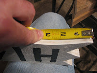Measure in 3 inches from each end on the bottom