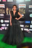 Esha Gupta in a Deep Neck Sleeveless Dark Green Gown at IIFA Utsavam Awards 2017     53.JPG