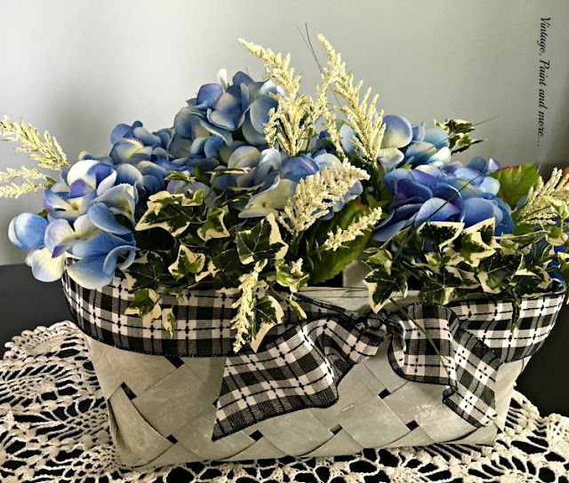 a plain market basket made into a vintage basket with hydrangeas for a table centerpiece