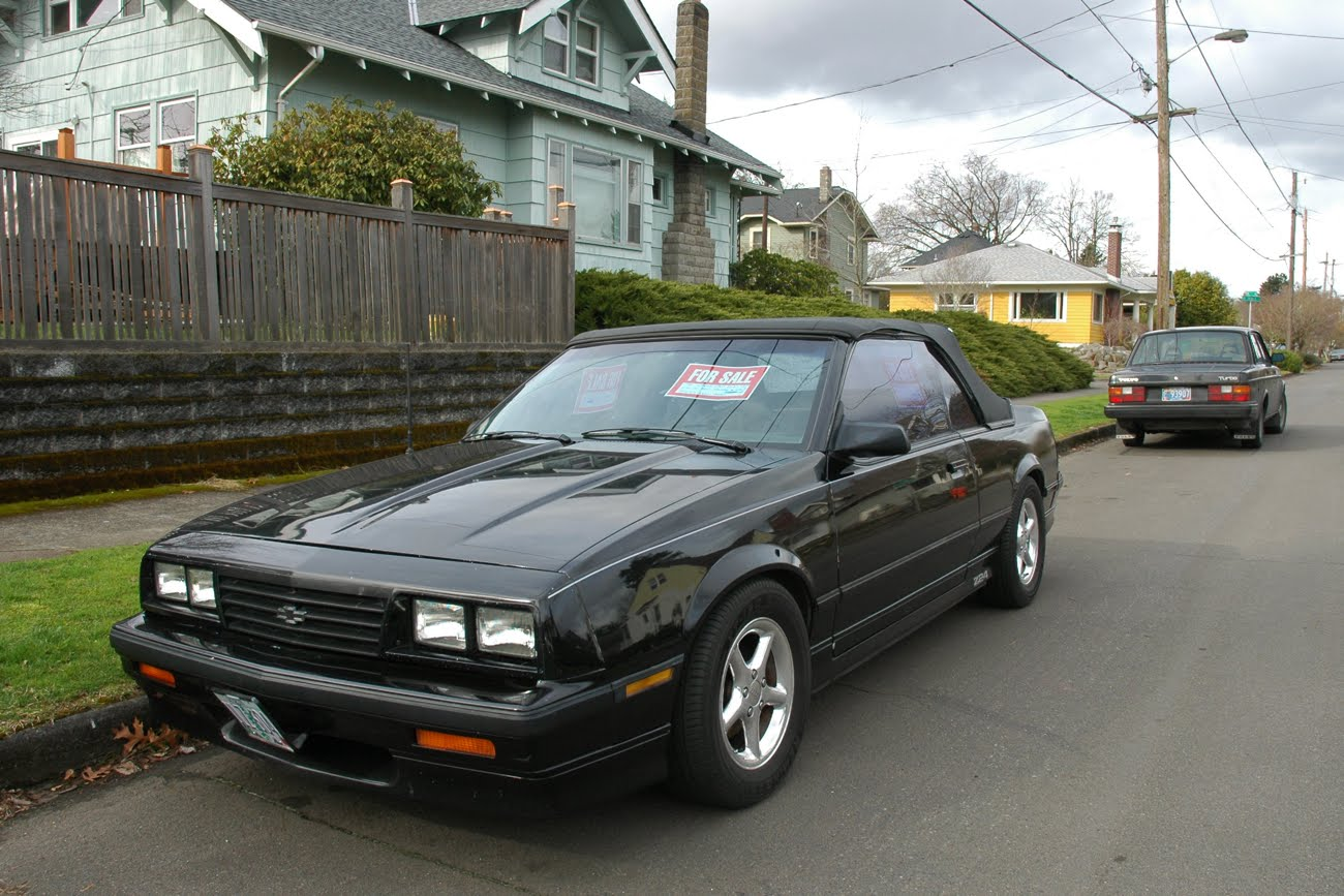 OLD PARKED CARS.: 1986 Chevrolet Cavalier Z24 Convertible.