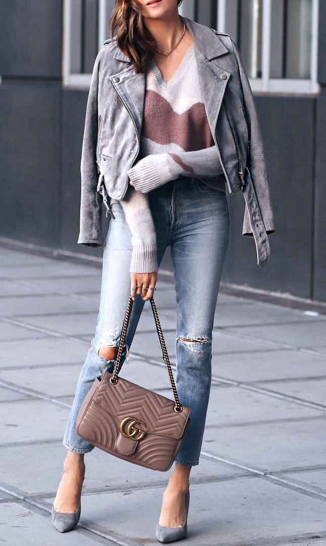stylish look | sweater + grey moto jacket + bag + heels + ripped jeans