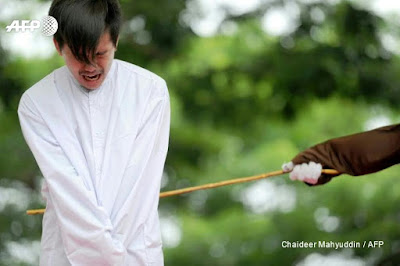 Photos/video: Two men publicly given 85 strokes of cane in Indonesia for having gay sex