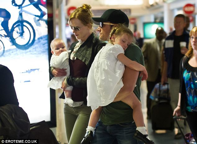 Beautiful babes in arms: Nicole Kidman and Keith Urban carry their pair of gorgeous girls as they jet out of LAX