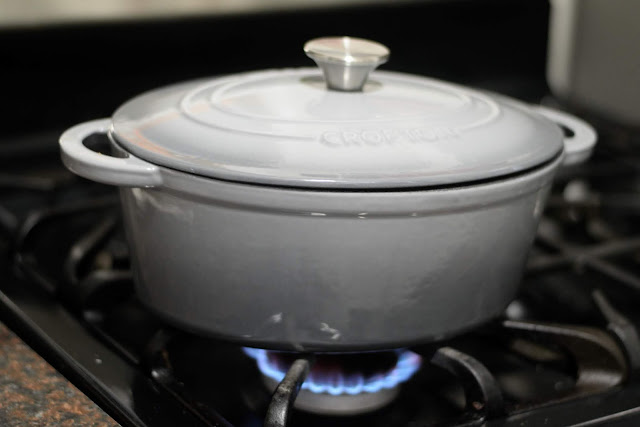 The soup pot on the stove over medium/high heat.