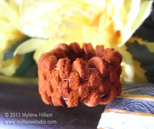Terracotta coloured suede lace woven leather ring