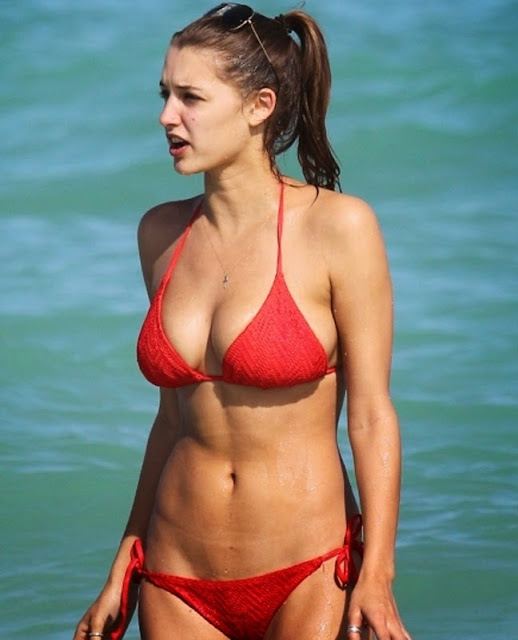 Alyssa Arce in red bikini on the beach