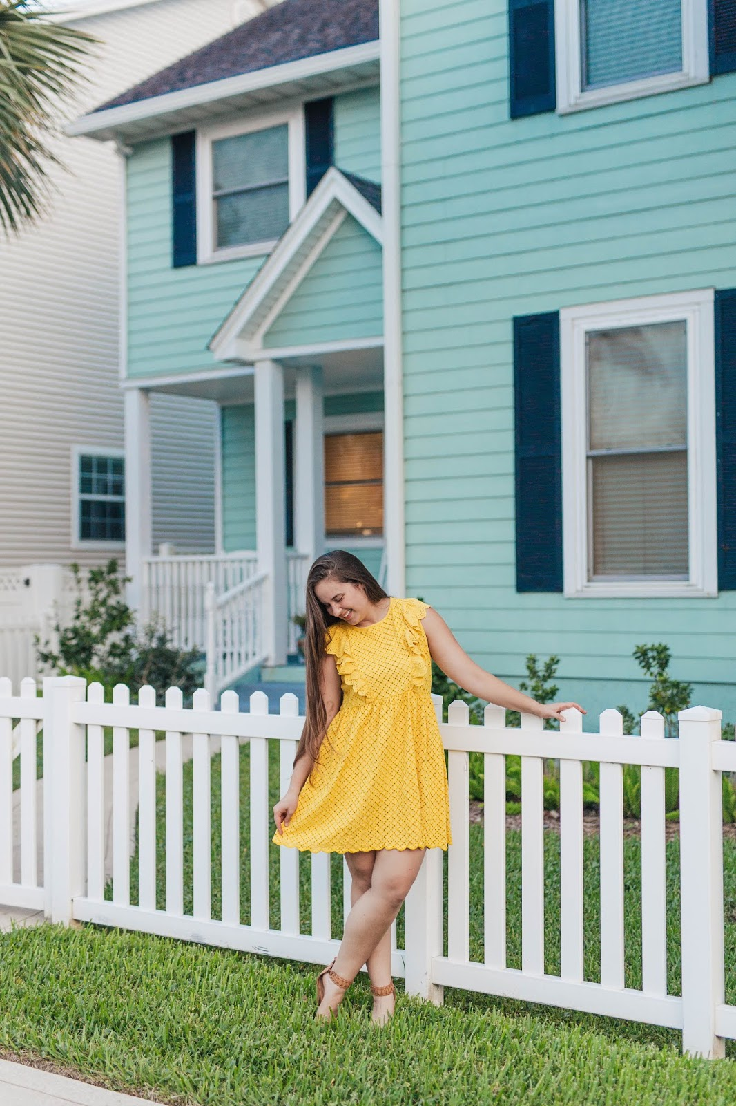 Brunette girl wearing yellow asos design broderie sundress with frill sleeves