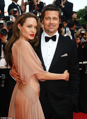 The woman rumoured to be behind Brad Pitt and Angelina Jolie's divorce speaks out, denies any affair, confirms she is pregnant
