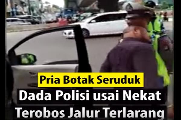 Terekam Pria Botak Seruduk Dada Polisi Setelah Nekat Terobos Jalur Terlarang